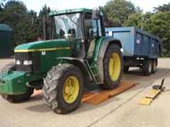 Tractor on portable weigh beams